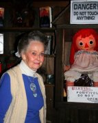 The real Lorraine Warren posing with the real Annabelle doll